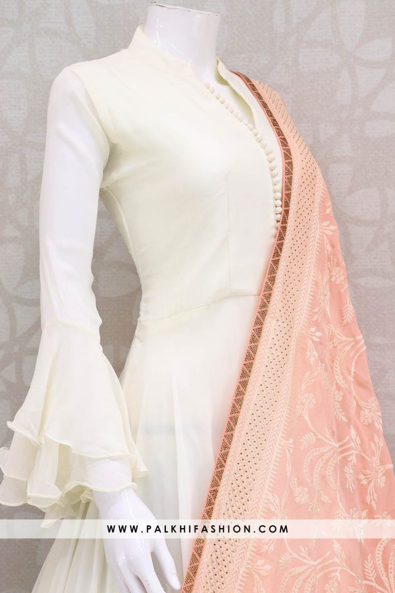 Palkhi fashion presents white color floor length georgette salwar suit with peach georgette dupatta with self color embroidery & petite stone work