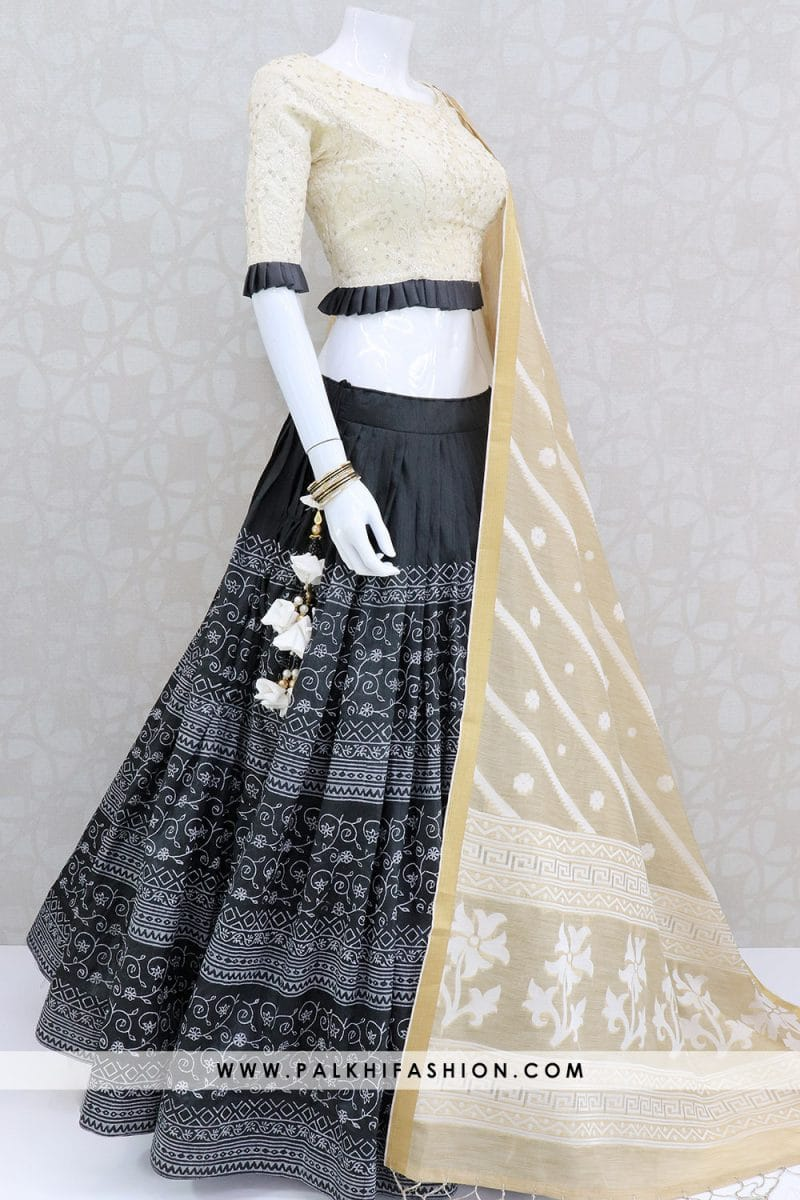 Black designer lehenga choli from palkhi fashion with appealing prints.beige blouse enriched with lakhnavi thread embellishments & beige art silk dupatta