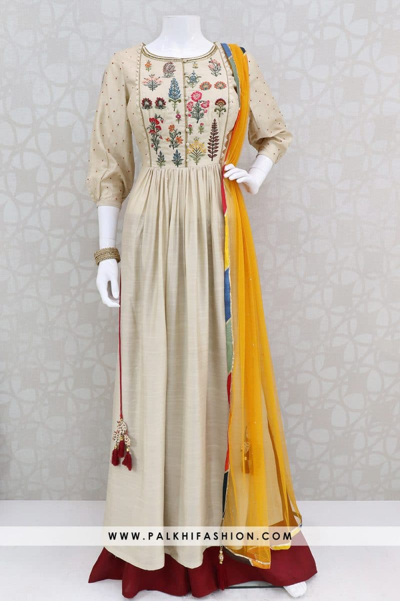 beige silk palazzo suit from palkhi fashion.Kurta enhanced with resham,petite stone & color threads with maroon palazzo pants & light yellow net dupatta